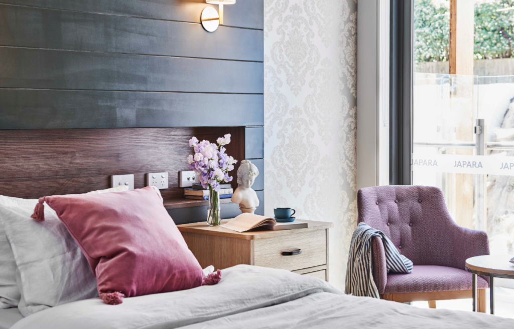 Contemporary bedroom featuring smart lighting and heating controls