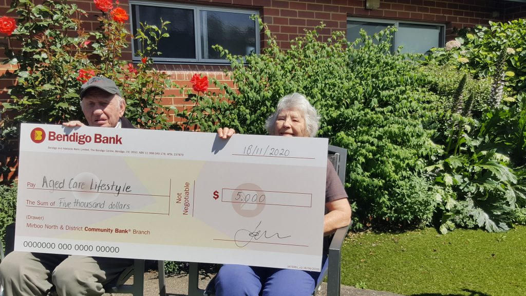 Residents at Japara Strzelecki House pose with large cheque