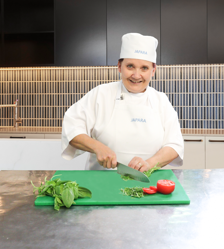 Female chef chopping vegetables at Trugo Place