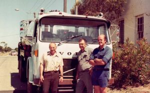 Noel and Ray Matthews standing in front of their truck