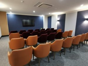 Cinema room with large screen and seating area