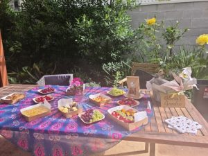 Breakfast foods laid out on an outdoor table for morning tea