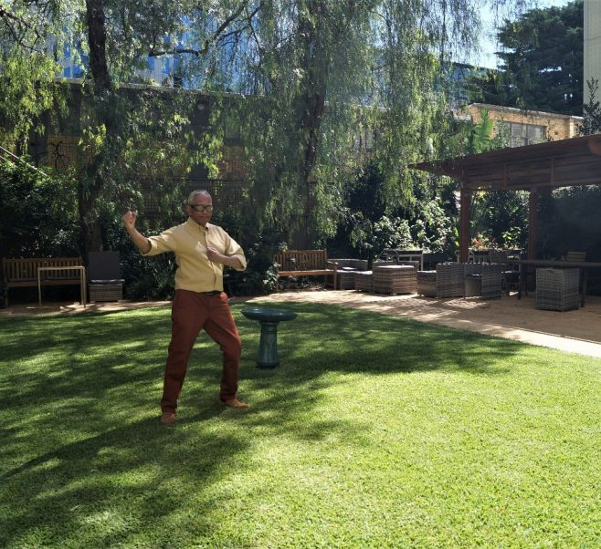 Toni doing Tai Chi in the garden at Central Park