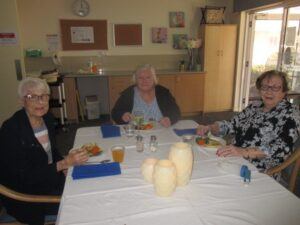 Sheila, Gloria and a friend eating together at Vonlea Manor