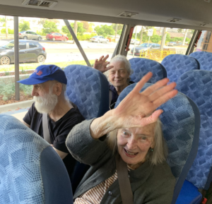 Trugo Place residents waving on the bus