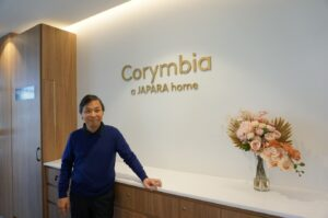 Corymbia Home Manager, Stanley Lam, smiling in our new home