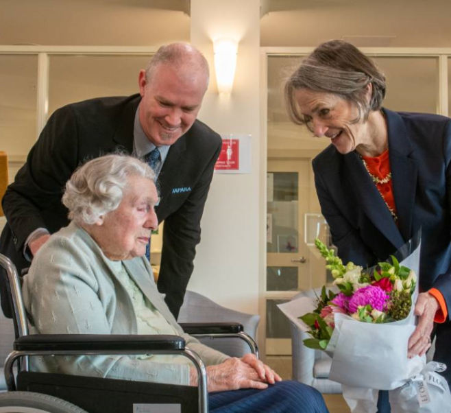 Eileen presenting the Tasmanian Governor, Kate Warner, with flowers